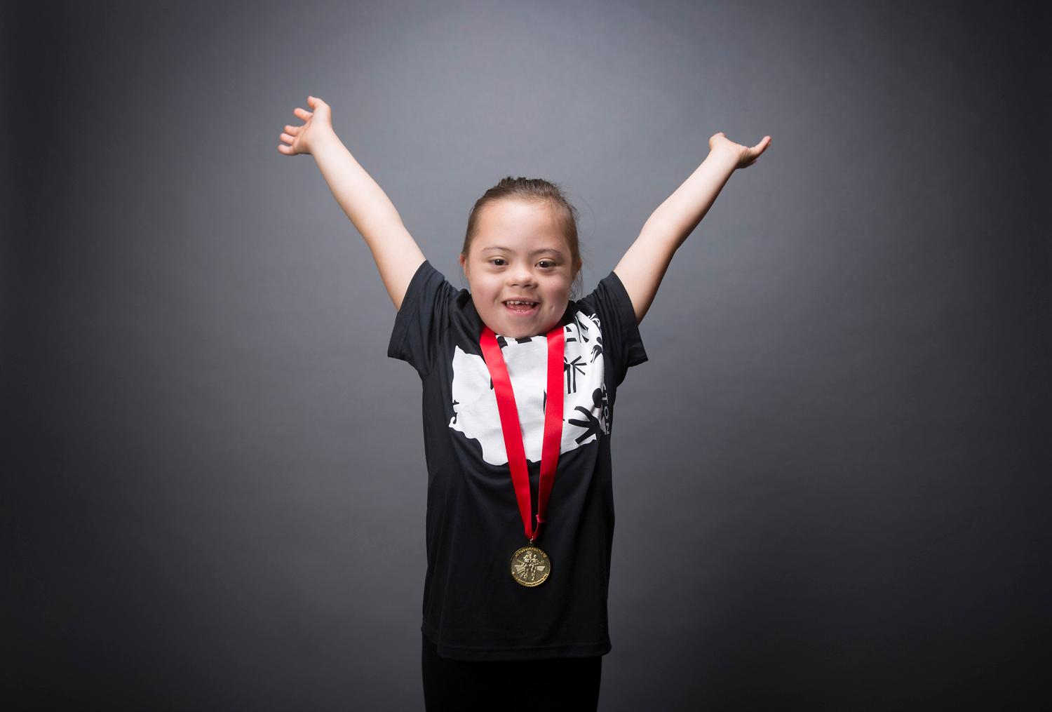 Introducing Frannie Ronan! Frannie will be competing in gymnastics. The Special Olympics USA will take place in Seattle from July 1-6, with a grand opening ceremony and Parade of Athletes and the lighting of the Special Olympics Flame of Hope. (Sy Bean / Seattle Refined)