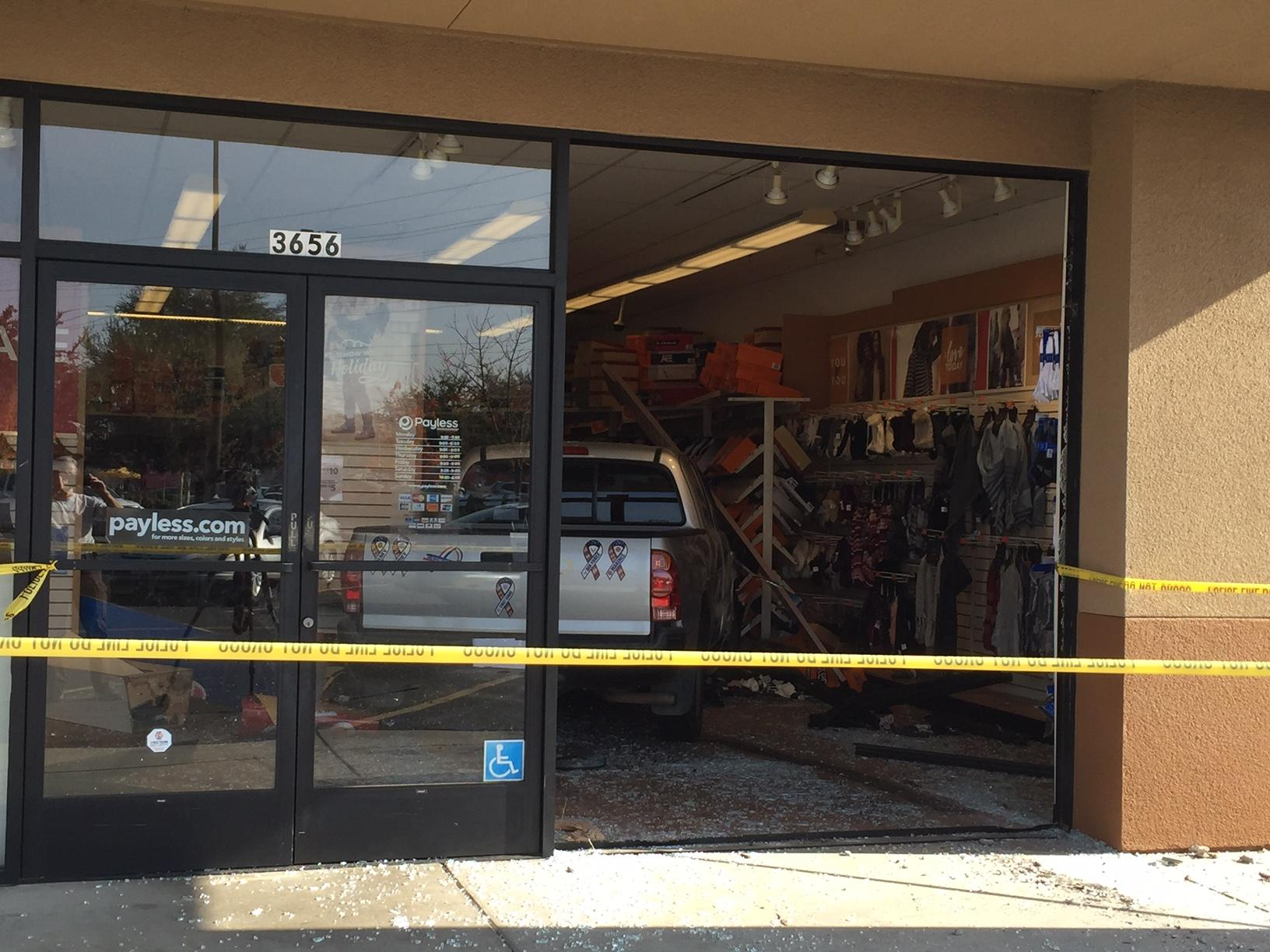 A pickup truck crashed through the glass in the front of a Payless ShoeSource store in Northwest Fresno on Thursday.