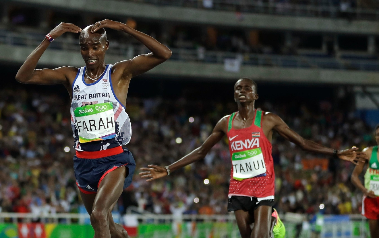 Britain's Mo Farah, left, and Kenya's silver medal winner Paul Kipngetich Tanui compete in the men's 10,000-meter final during the athletics competitions in the Olympic stadium of the 2016 Summer Olympics in Rio de Janeiro, Brazil, Saturday, Aug. 13, 2016. (AP Photo/Matt Slocum)