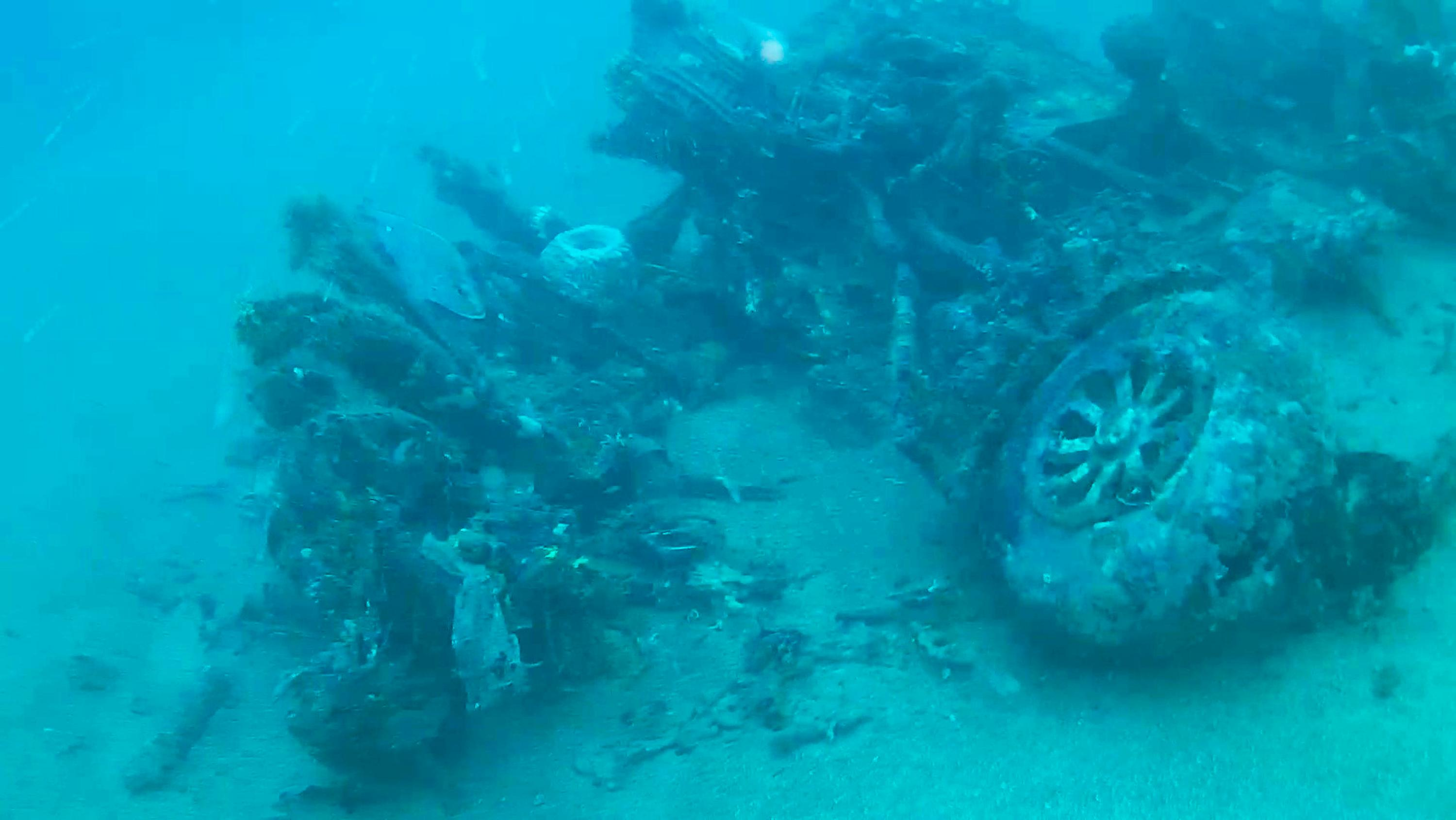 This October 2017 photo from a remote-controlled underwater camera provided by Project Recover shows the nose wheel of a B-24 bomber that crashed in Hansa Bay in what is now Papua New Guinea during World War II. When Tom Kelly's relatives got word that his bomber had been found, a wave of exhilaration mixed with grief washed over family members. Although relatives who never met Kelly had pieced much of his life story together over the years, they never knew what happened when his plane was shot down off the coast of Papua New Guinea in 1944. They got their answer recently when the group Project Recover found the B-24 bomber under 213 feet of water. (Project Recover via AP)