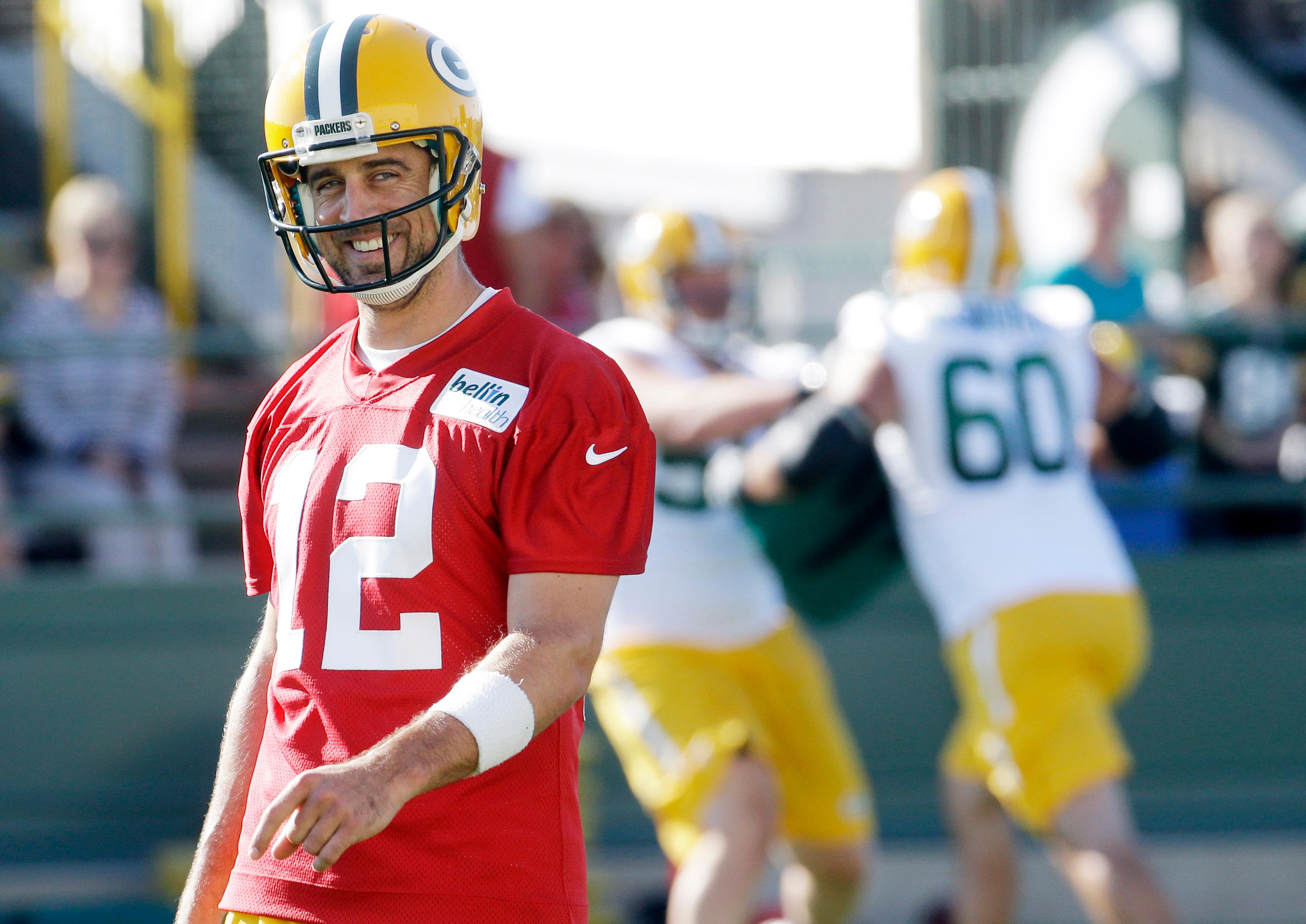 FILE- In this July 30, 2015, file photo, Green Bay Packers' Aaron Rodgers smiles during NFL football training camp in Green Bay, Wis. NASCAR driver Danica Patrick, a noted Chicago Bears fan, confirmed Monday. Jan. 15, 2018, she is dating Rodgers.   (AP Photo/Morry Gash, File)