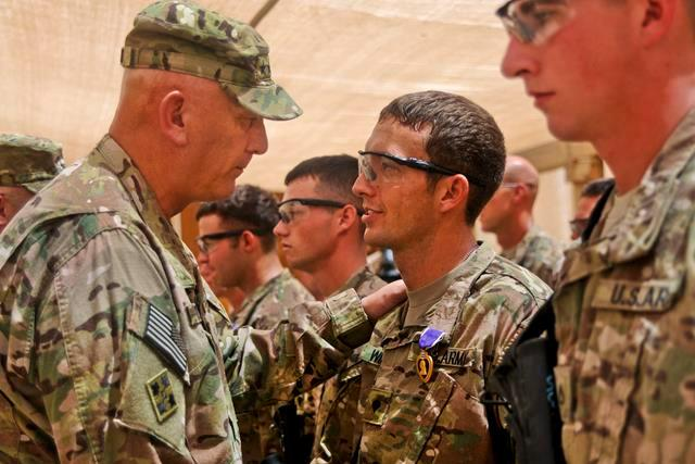 U.S. Army Chief of Staff Gen. Ray Odierno presents the Purple Heart to U.S. Army Spc. Thomas Wirthlin during a ceremony on Forward Operating Base Azzizullah, Afghanistan, Aug. 7, 2013.