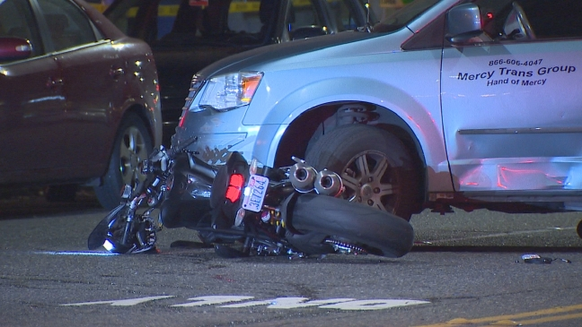 Bystanders try to save motorcyclist trapped under van in Ballard