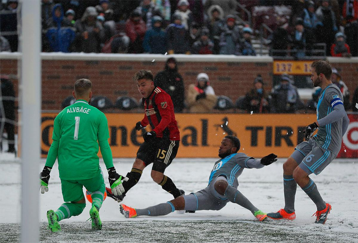 Atlanta United forward Hector Villalba (15) hurries a shot off while Minnesota United defender Jermaine Taylor (4) and goalkeeper John Alvbage (1) defend during the second half of an MLS soccer match Sunday, March 12, 2017, in Minneapolis, (Jeff Wheeler/Star Tribune via AP)