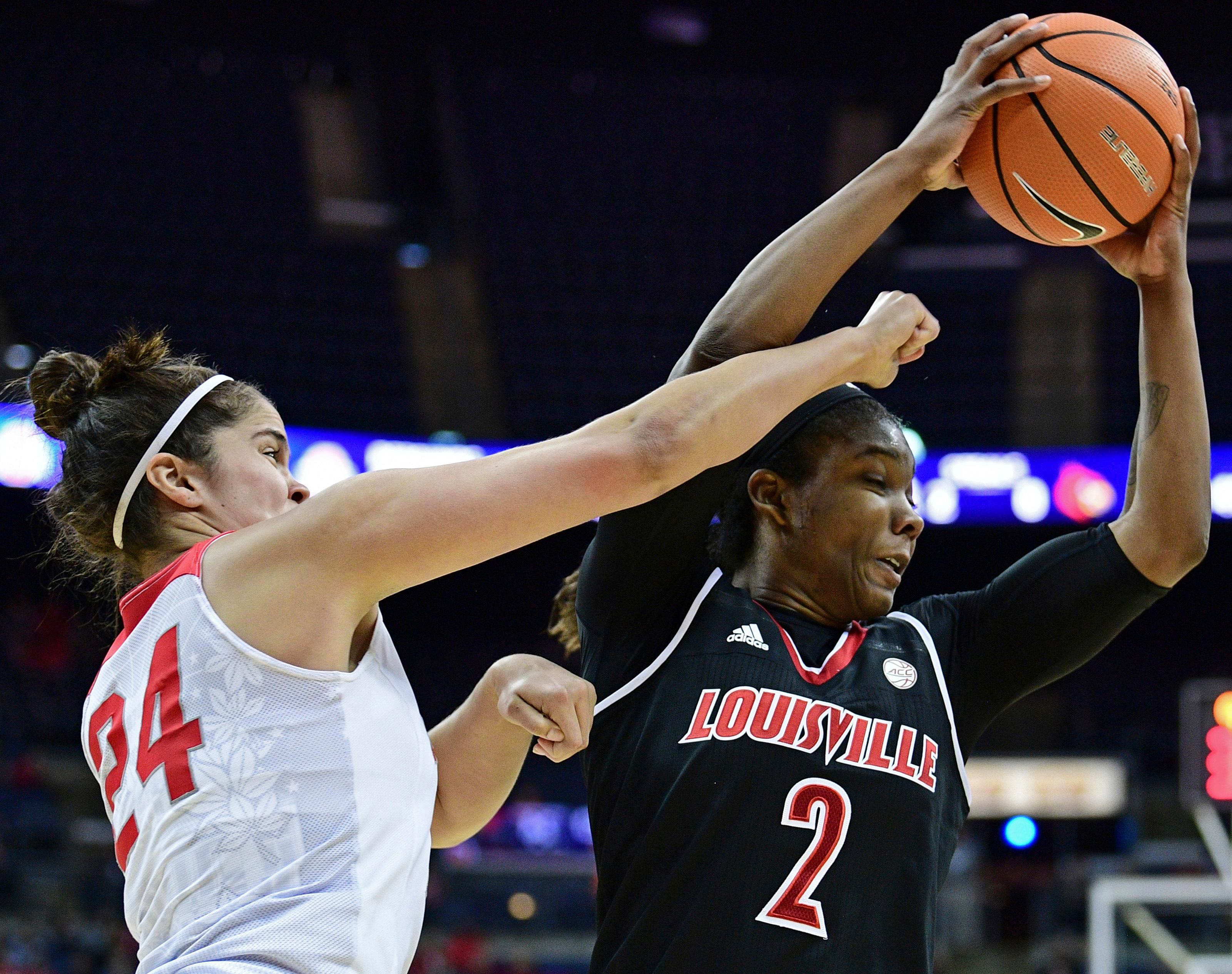 Louisville's Myisha Hines-Allen (2) rebounds against Ohio State's Makayla Waterman during the second quarter of an NCAA college basketball game, Sunday, Nov. 12, 2017, in Columbus, Ohio. (AP Photo/David Dermer)