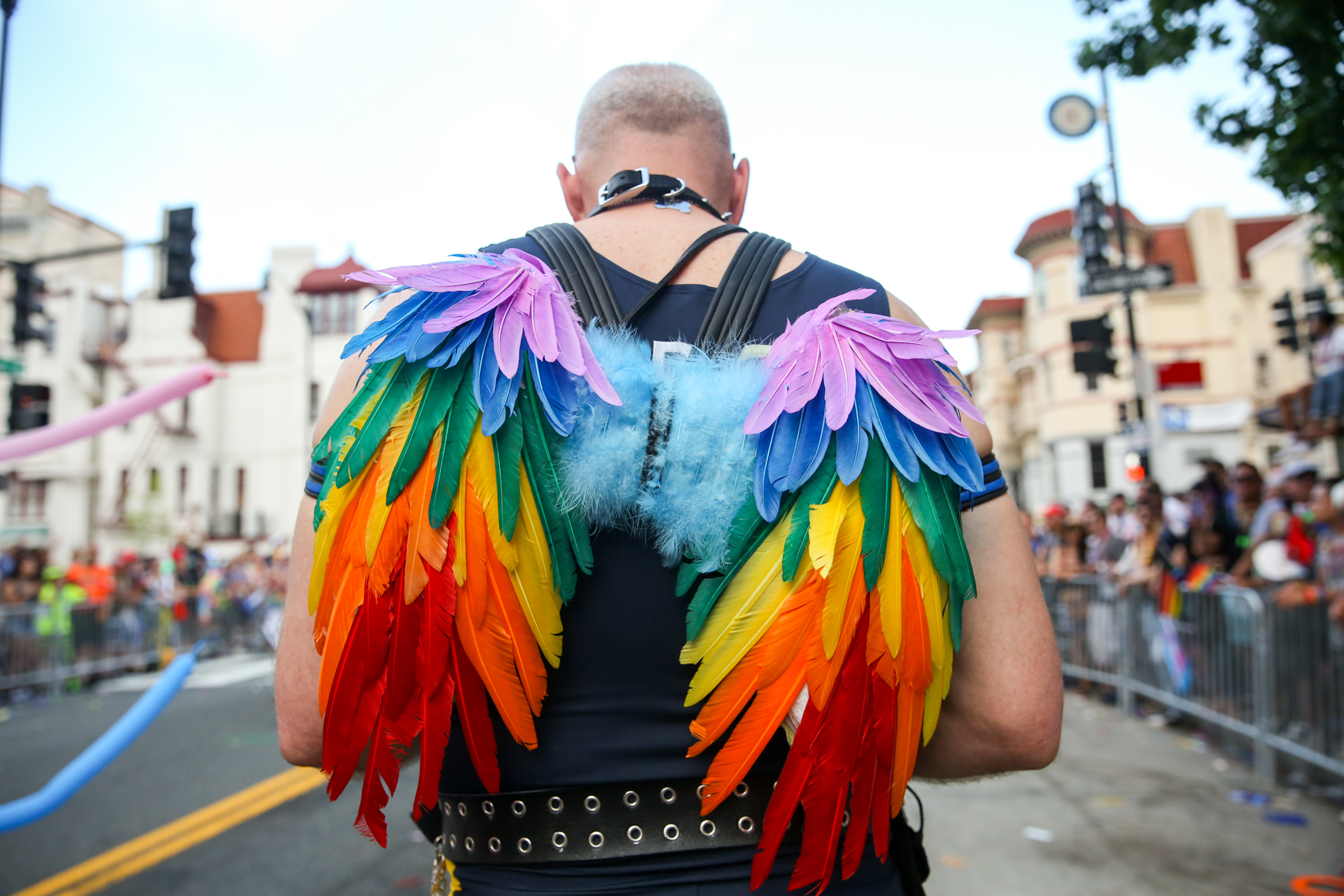 A{ }A man wears rainbow angel wings at the Washington, D.C. Pride parade in June.{ }(Amanda Andrade-Rhoades/DC Refined)