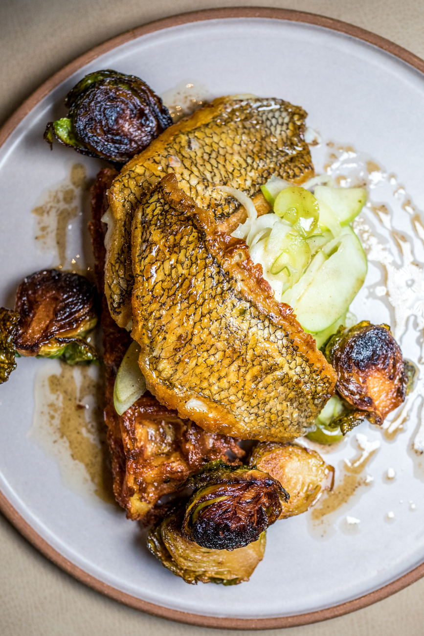 Atlantic Black Bass: potato waffle, apple slaw, brussels sprouts, and brown butter agrodolce / Image: Catherine Viox // Published: 11.18.20