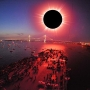 Turn around bright eyes: A total eclipse on the harbor