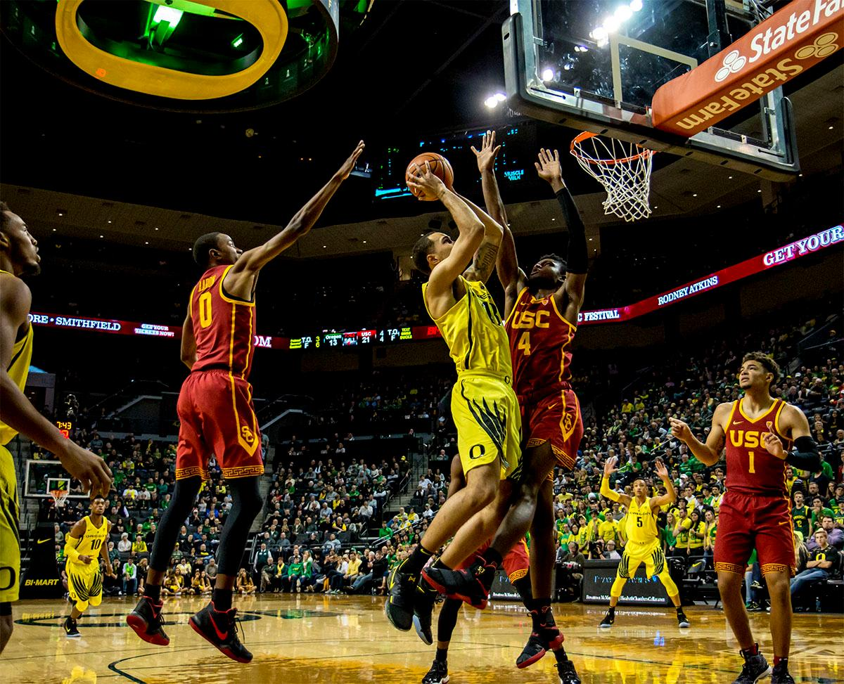 The Duck's Paul White (#13) makes a jump shot for the basket. The UO Ducks basketball team suffered a loss to the USC Trojans, 75-70, at Matthew Knight Arena on Thursday. Payton Pritchard lead the scoring with 18 points. The Ducks are now 2-4 in conference play and 12-7 overall. The Ducks will next play the UCLA at Matthew Knight Arena at 7:15 p.m. on Saturday, Jan. 20. Photo by August Frank, Oregon News Lab