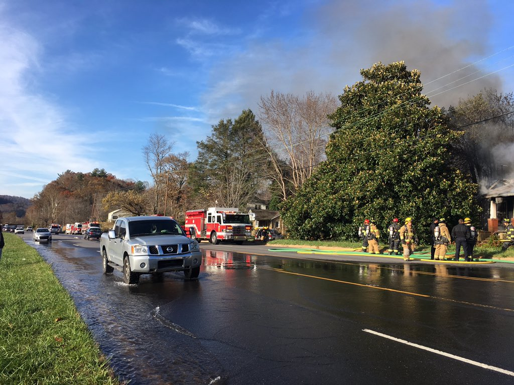 Several crews are working to put out a fire on Tunnel Road in the Swannanoa area (Photo by: WLOS staff)<p></p>