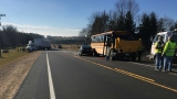 6 listed in good condition after school bus/semi crash