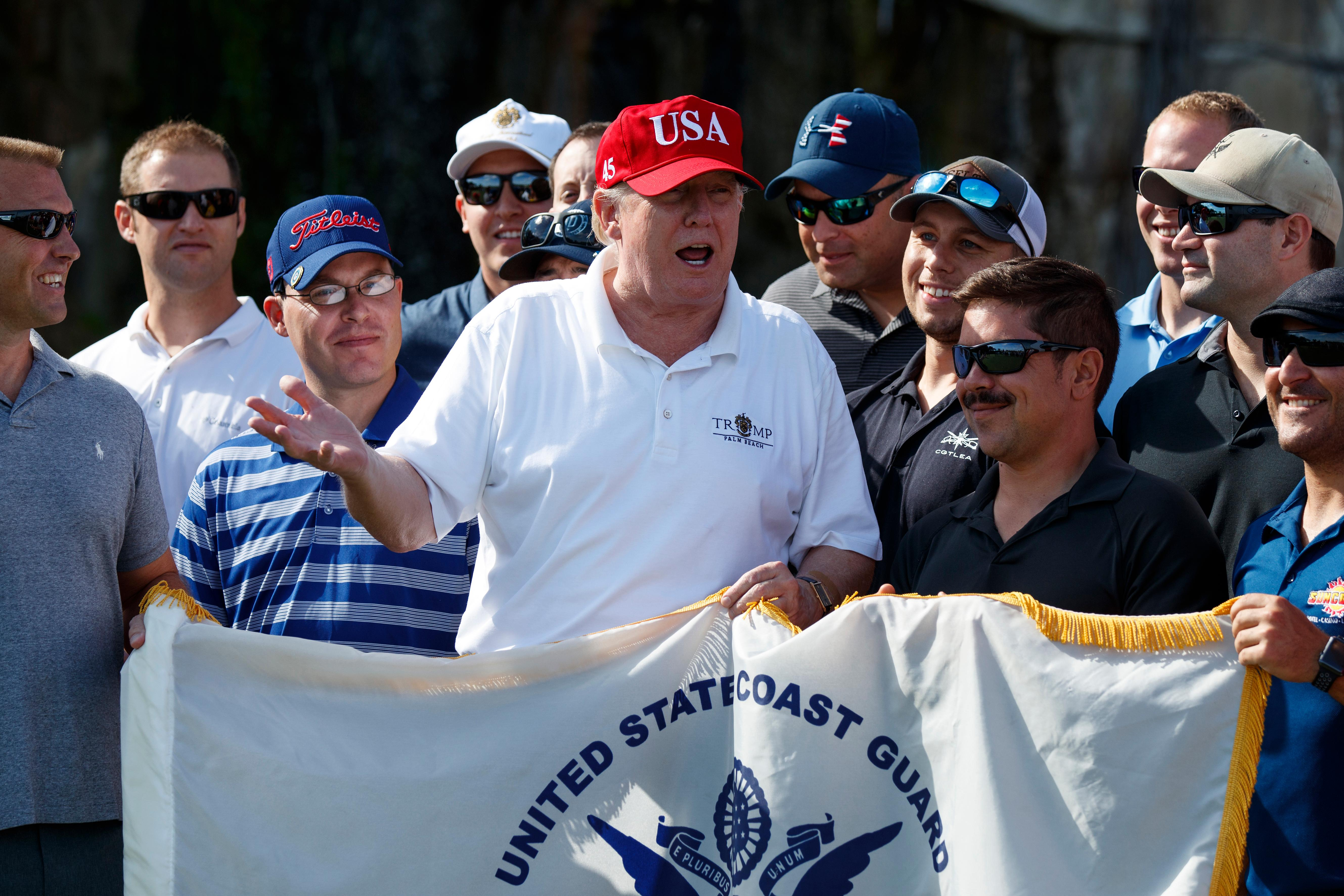 President Donald Trump speaks as he meets with members of the U.S. Coast Guard, who he invited to play golf, at Trump International Golf Club, Friday, Dec. 29, 2017, in West Palm Beach, Fla. (AP Photo/Evan Vucci)