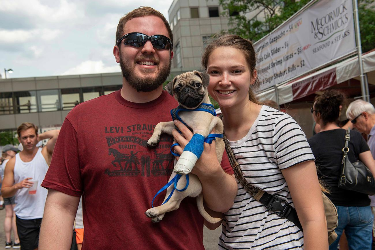 Andrew Banks of Florence with Kevin Malone (the pug) and Alexia Keeton of Owen County.  Kevin Malone took a fall from a bed and broke bones in his paw. / Image: Joe Simon // Published: 5.26.19