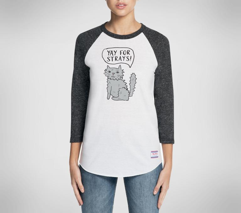 Support rescue animals with a tee ready to get taken out to the ballgame. The scruffy gray cat adds an adorable touch to this baseball tee. (Image: Courtesy Skechers)