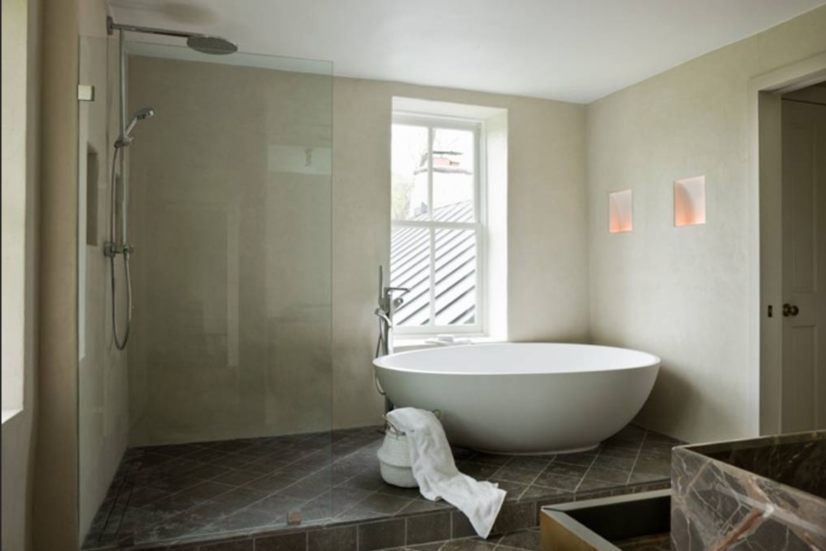 ... and the master bath boasts a massive stone tub that is just perfect to soak in. (Image: Ashley Hafstead)